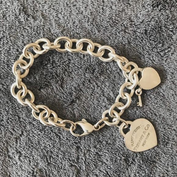 f64c929424c24 TIFFANY & CO Sterling Silver Charm Bracelet. M_5a47dad6b7f72b793216222c